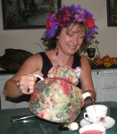 Colleen Skirvin Suddock  pouring tea at a Red Hat tea party!