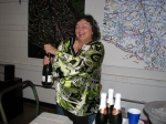 Carol having fun opening the bottles she brought for our toast